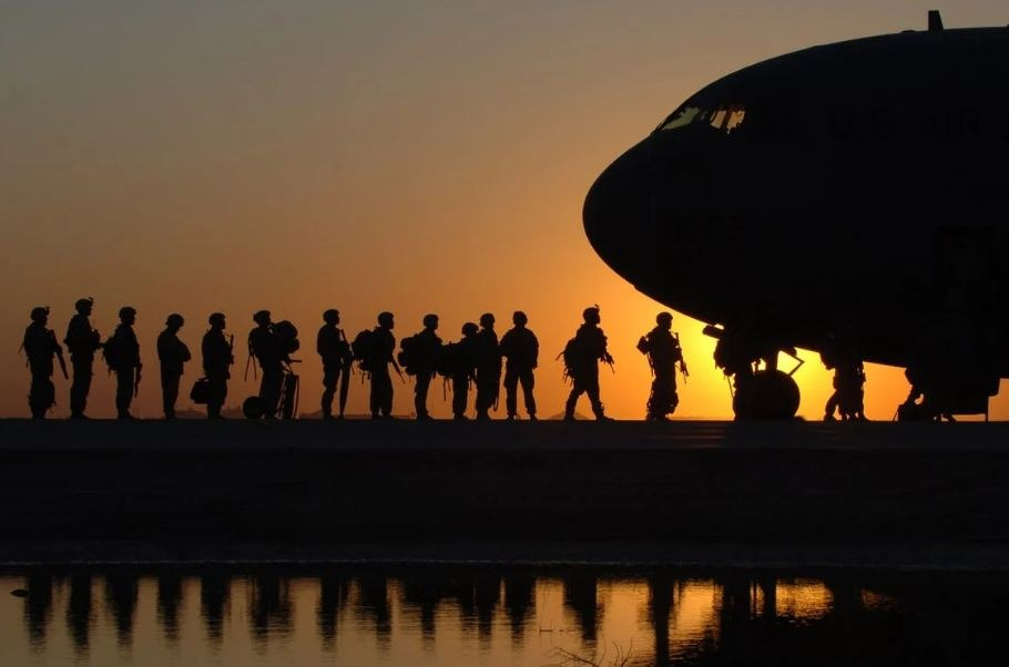 Soldiers In Line To Get In Plane