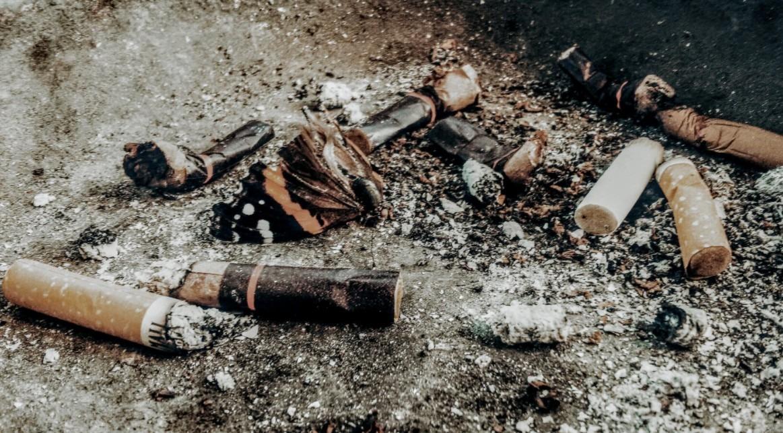 cigarette-buts-on-brown-soil